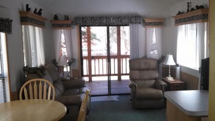 Deluxe Riverside Cabin 1